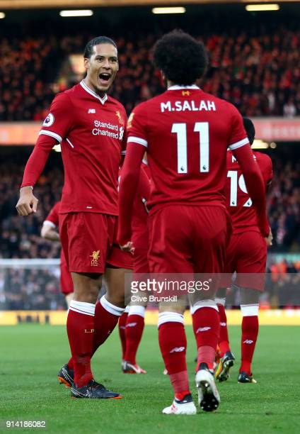 Mohamed Salah of Liverpool celebrates with teammate Virgil van Dijk after scoring his sides first goal during the Premier League match between...