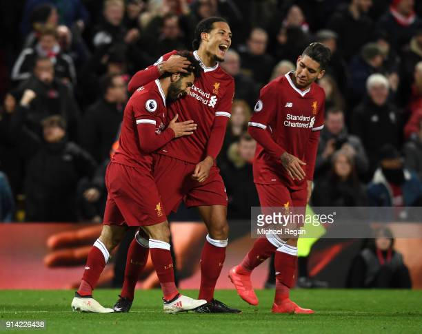 Mohamed Salah of Liverpool celebrates with teammate Virgil van Dijk after scoring his sides second goal during the Premier League match between...