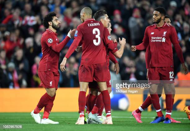 Mohamed Salah of Liverpool celebrates with teammates after scoring his team's second goal during the Group C match of the UEFA Champions League...