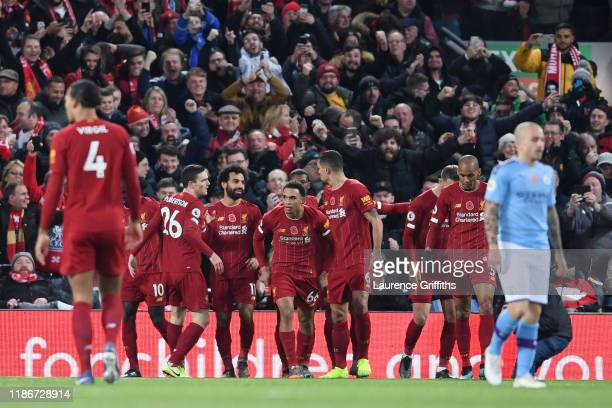Mohamed Salah of Liverpool celebrates with teammates after scoring his team's second goal during the Premier League match between Liverpool FC and...