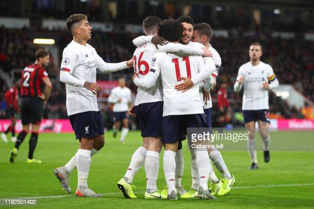 Mohamed Salah of Liverpool celebrates with teammates after scoring his team's third goal during the Premier League match between AFC Bournemouth and...