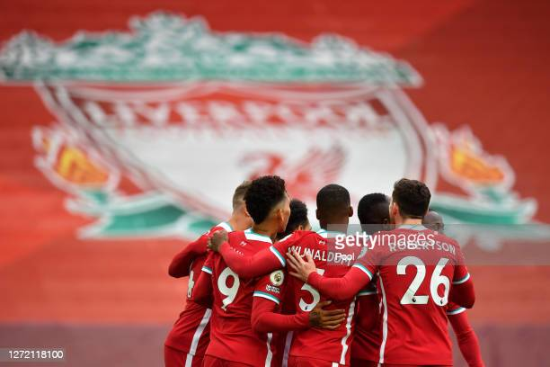 Mohamed Salah of Liverpool celebrates with teammates after scoring his team's first goal during the Premier League match between Liverpool and Leeds...