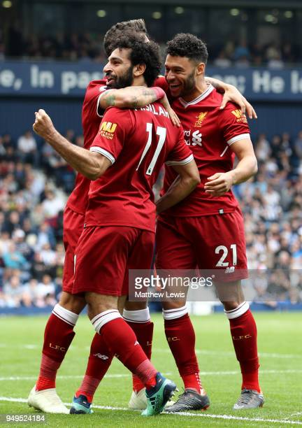 Mohamed Salah of Liverpool celebrates with teammates after scoring his sides second goal during the Premier League match between West Bromwich Albion...