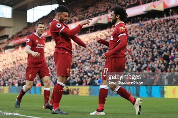 Mohamed Salah of Liverpool celebrates with teammates Alex OxladeChamberlain and James Milner after scoring their 2nd goal during the Premier League...