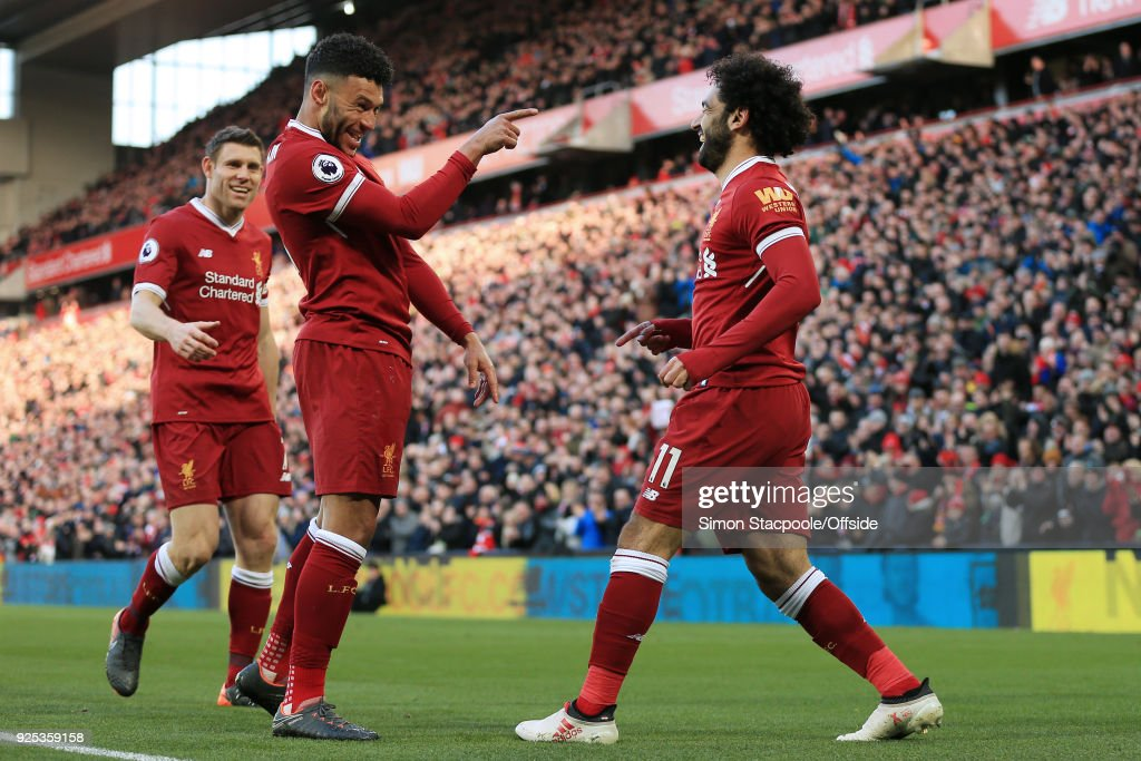 Mohamed Salah of Liverpool (R) celebrates with teammates Alex Oxlade-Chamberlain (C) and James Milner (L) after scoring their 2nd goal during the Premier League match between Liverpool and West Ham United at Anfield on February 24, 2018 in Liverpool, England.