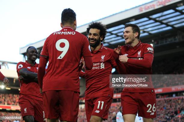 Mohamed Salah of Liverpool celebrates with teammates Andrew Robertson of Liverpool , Roberto Firmino of Liverpool and Sadio Mane of Liverpool after...