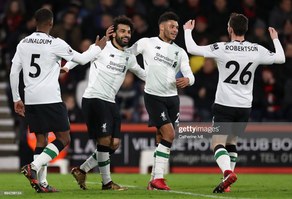 Mohamed Salah of Liverpool celebrates with teammates Georginio Wijnaldum, Alex Oxlade-Chamberlain, and Andy Robertson after scoring his sides third goal during the Premier League match between AFC Bournemouth and Liverpool at Vitality Stadium on December 17, 2017 in Bournemouth, England.
