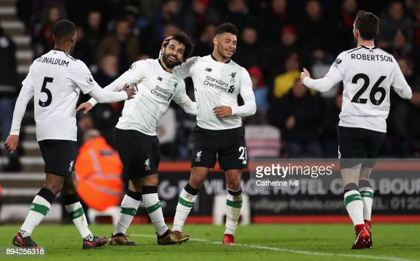 Mohamed Salah of Liverpool celebrates with teammates Georginio Wijnaldum Alex OxladeChamberlain and Andy Robertson after scoring his sides third goal...