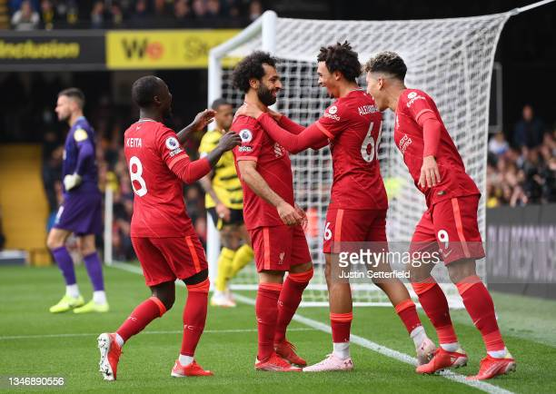 Mohamed Salah of Liverpool celebrates with teammates Naby Keita, Trent Alexander-Arnold and Roberto Firmino after scoring their side's fourth goal...