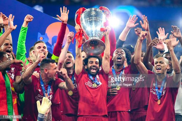 Mohamed Salah of Liverpool celebrates with the Champions League Trophy after winning the UEFA Champions League Final between Tottenham Hotspur and...