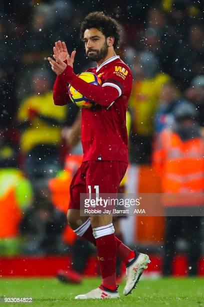 Mohamed Salah of Liverpool celebrates with the match ball at full time during the Premier League match between Liverpool and Watford at Anfield on...