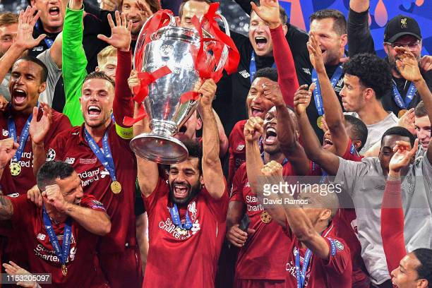 Mohamed Salah of Liverpool celebrates with the trophy at the end of the UEFA Champions League Final between Tottenham Hotspur and Liverpool at...