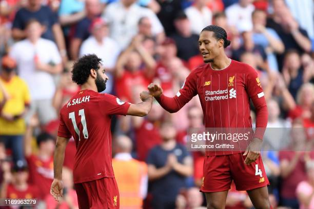 Mohamed Salah of Liverpool celebrates with Virgil van Dijk after scoring his team's second goal during the Premier League match between Liverpool FC...