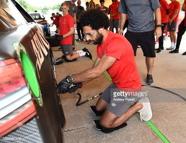Mohamed Salah of Liverpool changing tyres during a tour of Roush Fenway Racing on July 21 2018 in Charlotte North Carolina