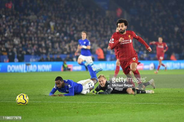 Mohamed Salah of Liverpool chases the ball after going past Kasper Schmeichel and Ricardo Pereira of Leicester City during the Premier League match...