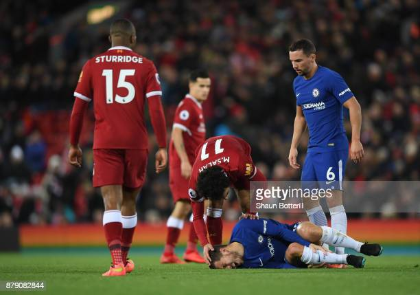 Mohamed Salah of Liverpool checks if Eden Hazard of Chelsea is okay after going down injured during the Premier League match between Liverpool and...