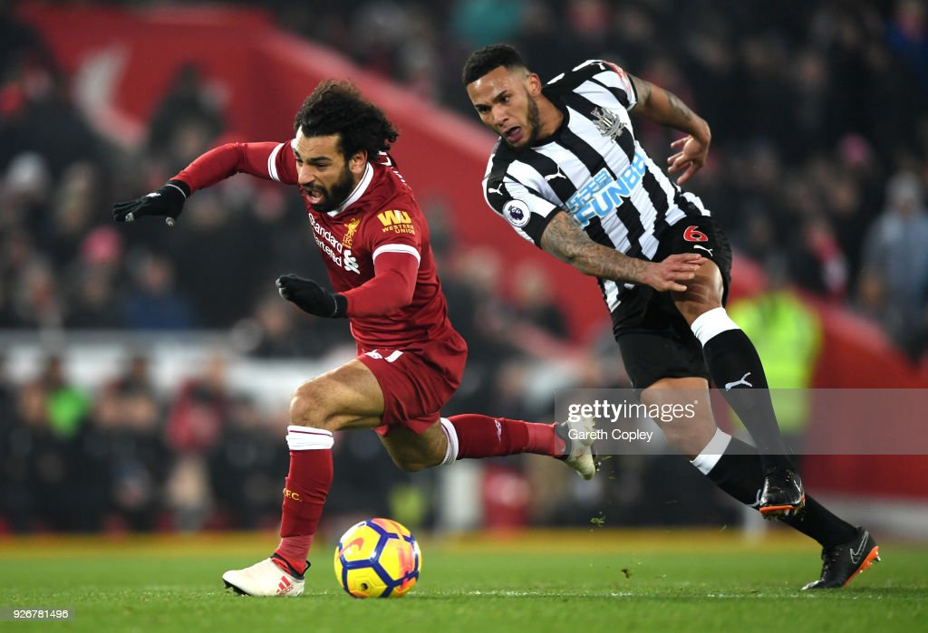 Mohamed Salah of Liverpool clashes with Jamaal Lascelles of Newcastle United during the Premier League match between Liverpool and Newcastle United at Anfield on March 3, 2018 in Liverpool, England.
