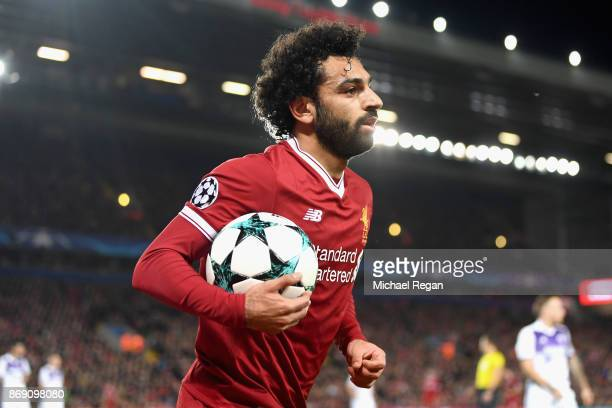 Mohamed Salah of Liverpool collects the ball during the UEFA Champions League group E match between Liverpool FC and NK Maribor at Anfield on...