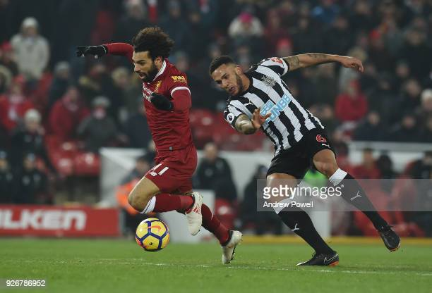 Mohamed Salah of Liverpool Comes Down in the box for a penalty claim at the end by Jamaal Lascelles of Newcastle during the Premier League match...
