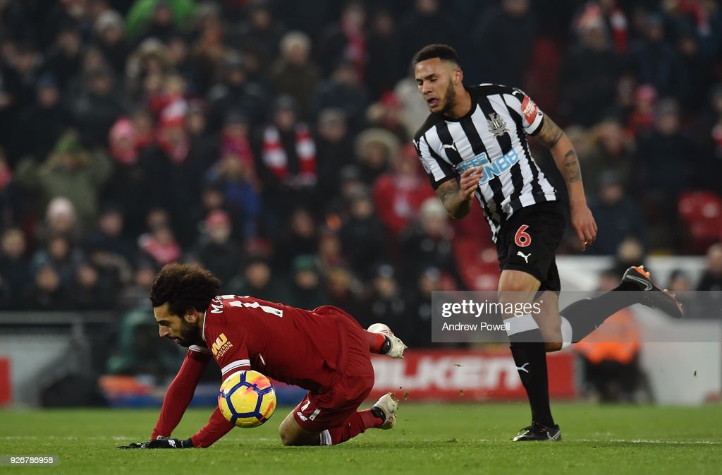 Mohamed Salah of Liverpool Comes Down in the box for a penalty claim at the end by Jamaal Lascelles of Newcastle during the Premier League match between Liverpool and Newcastle United at Anfield on March 3, 2018 in Liverpool, England.