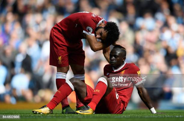 Mohamed Salah of Liverpool comforts Sadio Mane of Liverpool after he reacts to being sent off during the Premier League match between Manchester City...