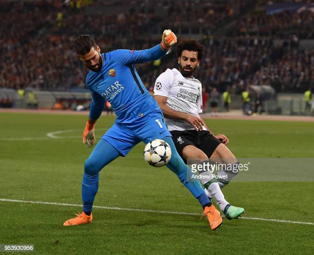 Mohamed Salah of Liverpool competes with Alisson Becker of AS Roma during the UEFA Champions League Semi Final Second Leg match between AS Roma and...