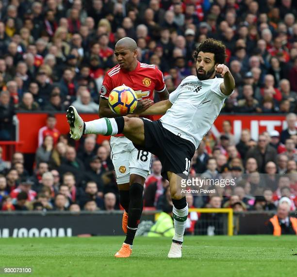 Mohamed Salah of Liverpool competes with Ashley Young of Manchester United during the Premier League match between Manchester United and Liverpool at...