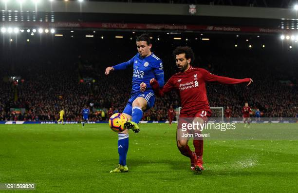 Mohamed Salah of Liverpool competes with Ben Chilwell of Leicester City during the Premier League match between Liverpool FC and Leicester City at...