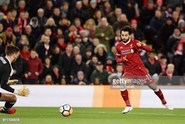 Mohamed Salah of Liverpool competes with Ben Fost of West Bromwich Albion during The Emirates FA Cup Fourth Round match between Liverpool and West...