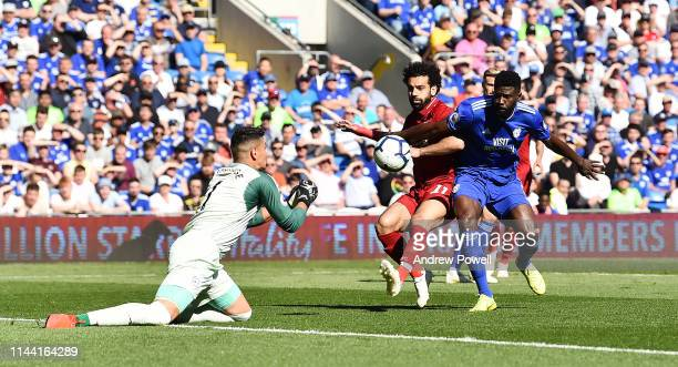 Mohamed Salah of Liverpool competes with Bruno Ecuele Manga of Cardiff City during the Premier League match between Cardiff City and Liverpool FC at...