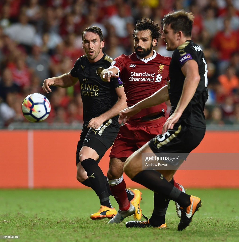 Mohamed Salah of Liverpool competes with Christian Fuchs and Harry Maguire of Leicester City during the Premier League Asia Trophy match between Liverpool FC and Leicester City FC at the Hong Kong Stadium on July 22, 2017 in Hong Kong, Hong Kong.