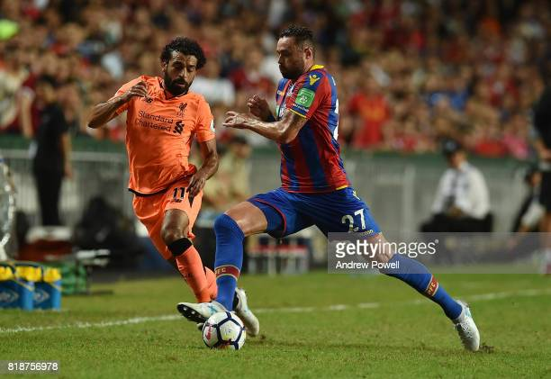 Mohamed Salah of Liverpool competes with Damien Delaney of Crystal Palace during the Premier League Asia Trophy match between Liverpool FC and...