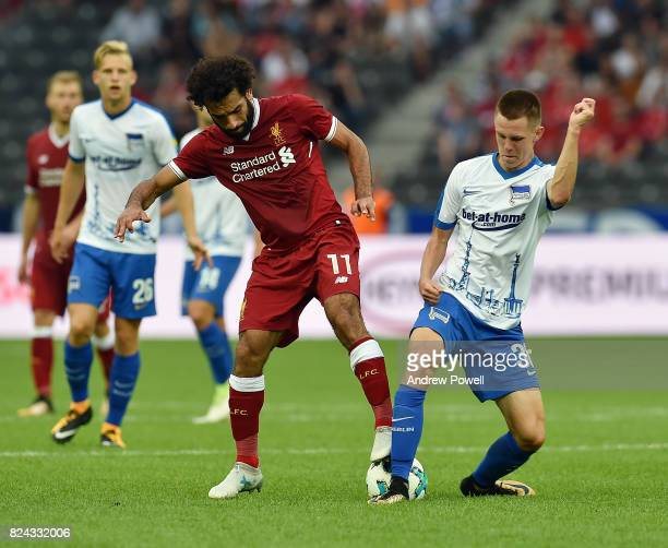 Mohamed Salah of Liverpool competes with Kade Julius of Hertha BSC during the preseason friendly match between Hertha BSC and FC Liverpool at...