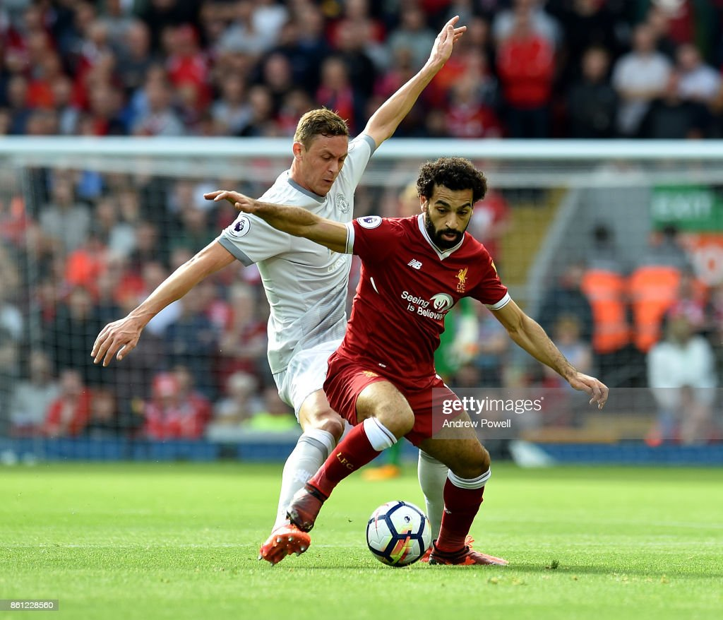 Mohamed Salah of Liverpool competes with Memanja Matic of Manchester United during the Premier League match between Liverpool and Manchester United at Anfield on October 14, 2017 in Liverpool, England.