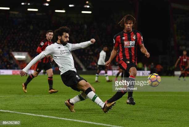 Mohamed Salah of Liverpool competes with Nathan Ake of AFC Bournemouth during the Premier League match between AFC Bournemouth and Liverpool at...