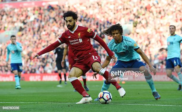 Mohamed Salah of Liverpool competes with Nathan Ake of AFC Bournemouth during the Premier League match between Liverpool and AFC Bournemouth at...