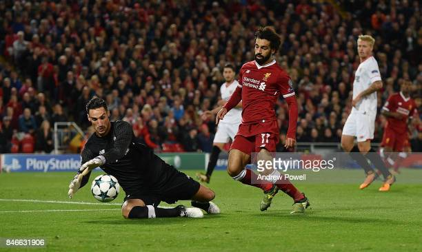 Mohamed Salah of Liverpool competes with Sergio Rico of Sevilla FC during the UEFA Champions League group E match between Liverpool FC and Sevilla FC...
