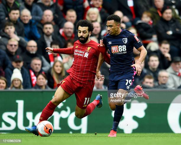 Mohamed Salah of Liverpool competing with Junior Stanislas of AFC Bournemouth during the Premier League match between Liverpool FC and AFC...