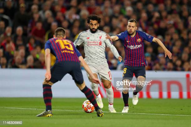 Mohamed Salah of Liverpool controls the ball as Clement Lenglet of Barcelona and Jordi Alba of Barcelona looks on during the UEFA Champions League...