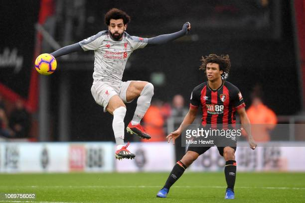 Mohamed Salah of Liverpool controls the ball as Nathan Ake of AFC Bournemouth looks on during the Premier League match between AFC Bournemouth and...