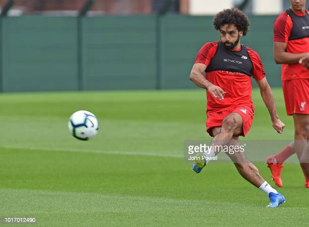 Joel Matip of Liverpool kicks the ball during a training session at Melwood Training Ground on August 15 2018 in Liverpool England