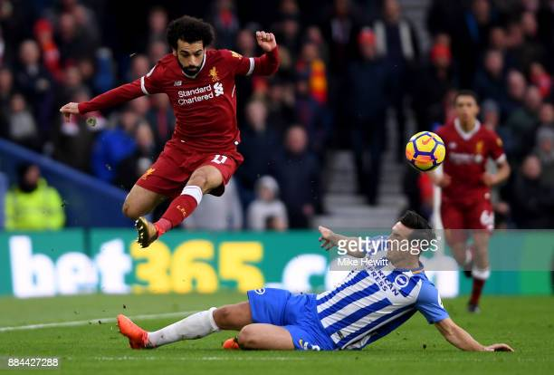 Mohamed Salah of Liverpool escapes a challenge from Lewis Dunk of Brighton and Hove Albion during the Premier League match between Brighton and Hove...