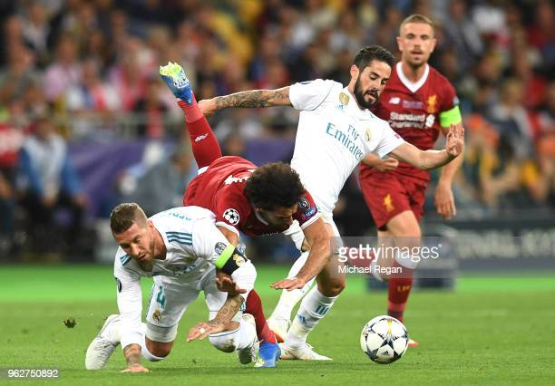 Mohamed Salah of Liverpool falls and lands on his shoulder after a collision with Sergio Ramos of Real Madrid, leading to him going off injured...