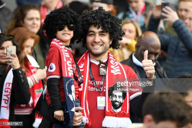 Mohamed Salah of Liverpool fans enjoy the match atmosphere ahead ofthe Premier League match between Fulham FC and Liverpool FC at Craven Cottage on...