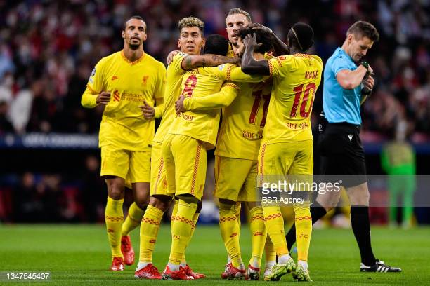 Mohamed Salah of Liverpool FC celebrates after scoring his sides first goal with Sadio Mane of Liverpool FC, Naby Keita of Liverpool FC and Roberto...