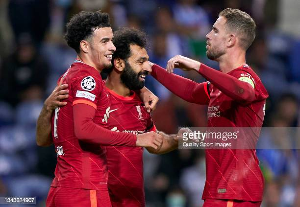 Mohamed Salah of Liverpool FC celebrates after scoring his team's third goal with his teammates Curtis Jones and Jordan Henderson during the UEFA...