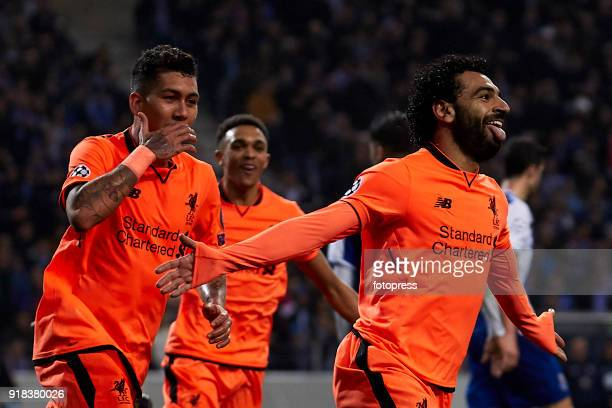 Mohamed Salah of Liverpool FC celebrates with his teammates after scoring his team's second goal during the UEFA Champions League Round of 16 First...