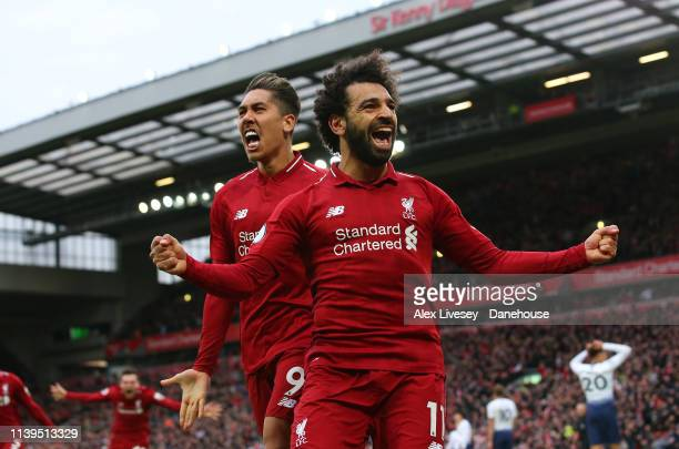 Mohamed Salah of Liverpool FC celebrates with Roberto Firmino after scoring their second goal during the Premier League match between Liverpool FC...