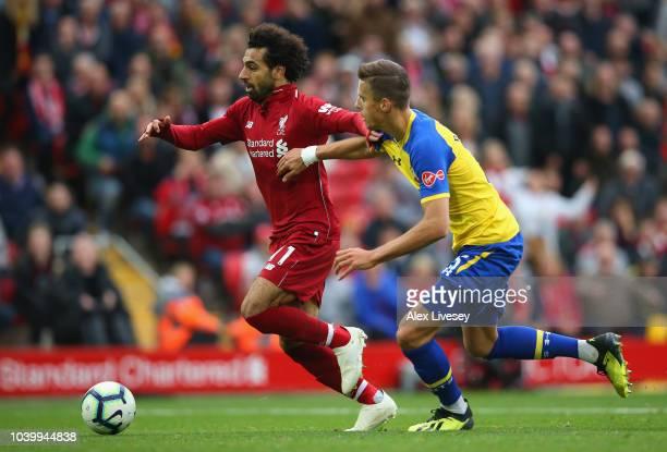 Mohamed Salah of Liverpool FC runs past Jan Bednarek of Southampton during the Premier League match between Liverpool FC and Southampton FC at...