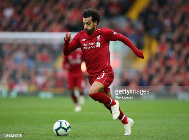 Mohamed Salah of Liverpool FC runs with the ball during the Premier League match between Liverpool FC and Southampton FC at Anfield on September 22...